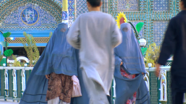 Women in burkha outside mosque, Afghanistan.