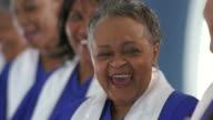 CU Women in gospel choir laughing in church / Port Gamble, Washington State, USA