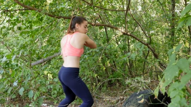 Women in Sport. the girl beats a car tire