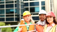 Women in STEM - engineer or architect team working on a construction project in city.