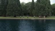 Women jogging next to a pond