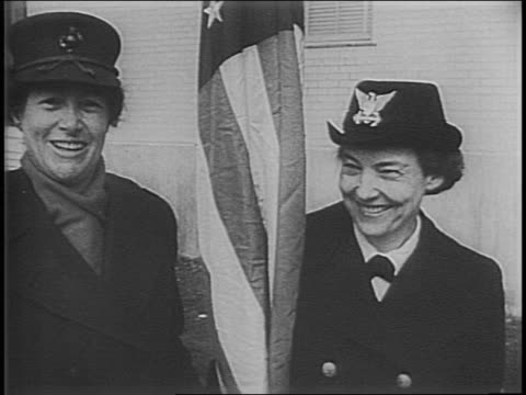 Women lined up at desk receive applications / close up of woman in uniform handing out applications / close up of Marine uniform cap on woman's head...