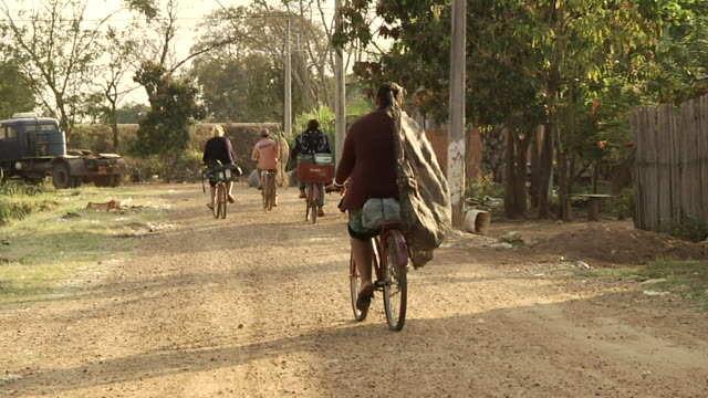 MS ZI Women moving on bicycles with nets to going fishing / Mato Grosso do Sul, Brazil