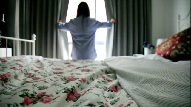 women open the curtain