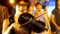 women play violin