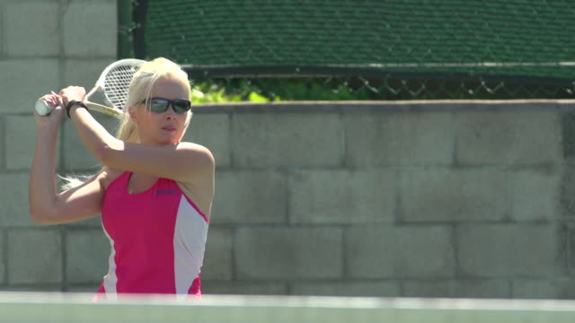 Women playing tennis. - Slow Motion