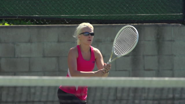 Women playing tennis. - Super Slow Motion - filmed at 240 fps