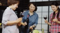 Women Pouring Wine for Toast