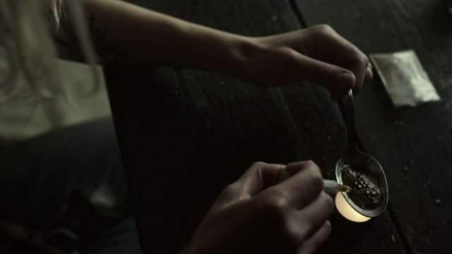 Women preparing heroin for use