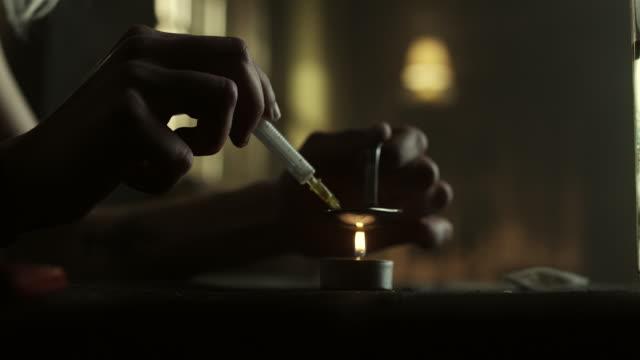 Women preparing heroin for use
