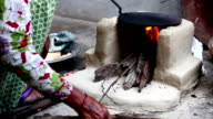 Women Preparing Mud Stove for Cooking Food