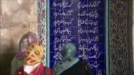 MS TU TD Women reading inscription at Tomb of Poet Saadi, Shiraz, Iran