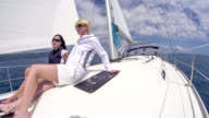 WS Women Relaxing On A Sailboat