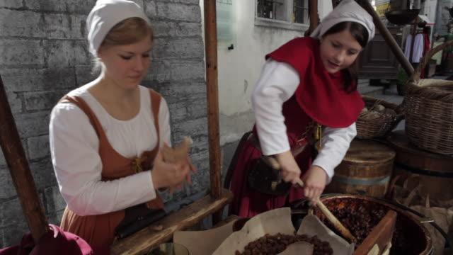 MS Women roasting almonds / Tallinn, Estonia
