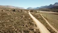 Women runs along a dirt road in the Cederberg Mountains
