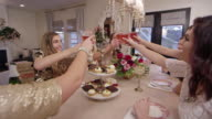 Women share a toast at a Holiday Christmas party