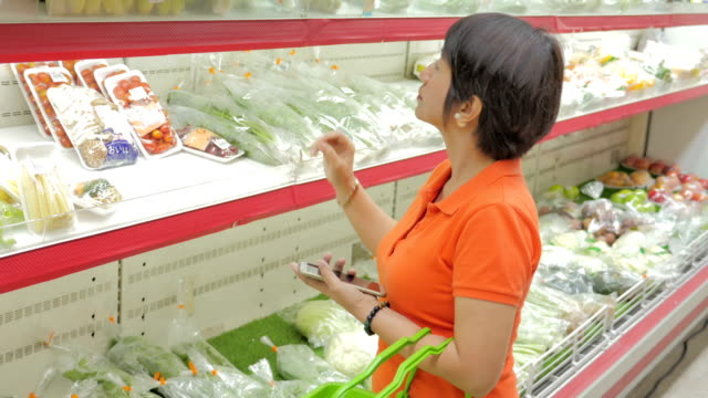 Women shopping fruits and vegetables in supermarket