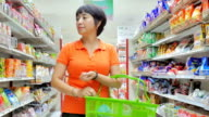 Women shopping in supermarket,Slow motion
