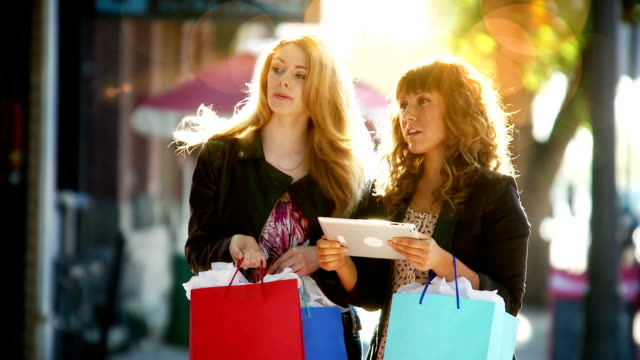 Women shopping with internet tablet