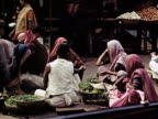 1939 MS women sitting and selling vegetables in market/ Bombay, India