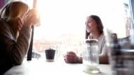 Women sitting in a cafe