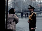 Women sobs in street and pleads to guard over Shah Mohammed Reza Pahlavi being forced into exile Tehran 17 Jan 79