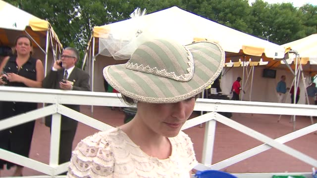 Women spectators wear large traditional hats at Arlington Million at Arlington Park in Arlington Heights Ill on Aug 16 2014