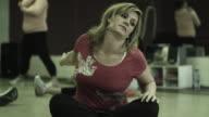 MS TU Women stretching in gym / Bontiful, Utah, USA