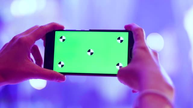Women Taking Photo With Smart Phone, Green Screen