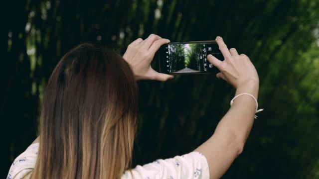 Women Taking Photo With Smart Phone