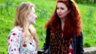 Women talking outdoor at city park