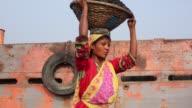 Women unloading coal from cargo in Dhaka Bangladesh on March 06 2017 Women workforce growing fast in Bangladesh they work same as man Bangladeshi...