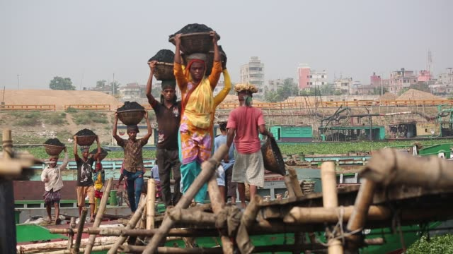 Women unloading coal from cargo in Dhaka Bangladesh on March 06 2017 Women workforce growing fast in Bangladesh they work same as man Bangladeshi...