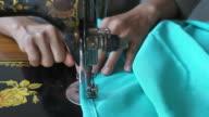 Women use sewing machine.