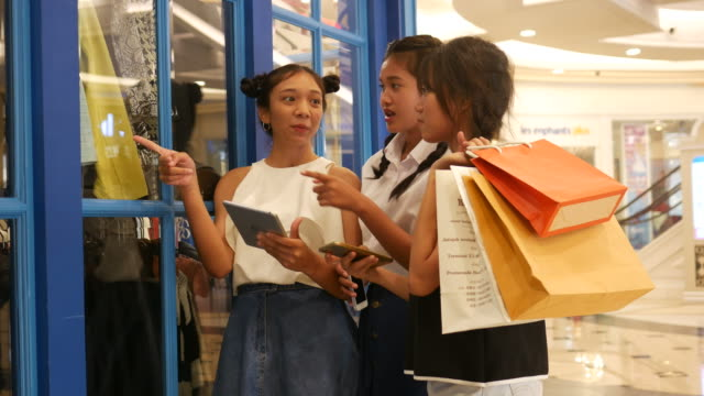 women using digital tablet and smart phone while shopping
