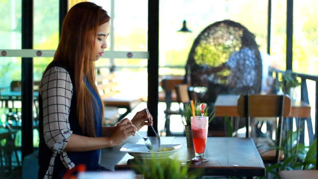 Women using pad and having Breakfast in cafe