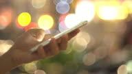 Women using smart phone defocused
