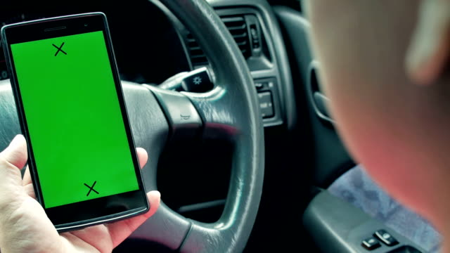 women using smart phone in the car, Green screen
