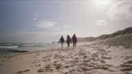 3 women walking at the beach, Mornington Peninsula, Victoria, Australia