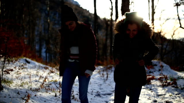 Women Walking In Nature On Cold Winter Day