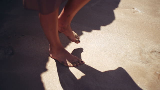 Women walking on sand