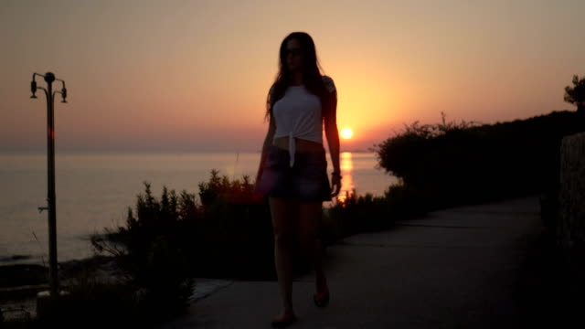 Women walking on the sunset