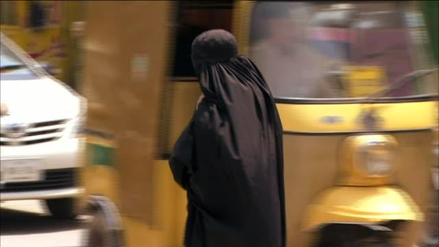 Women walking through busy street in the Swat District