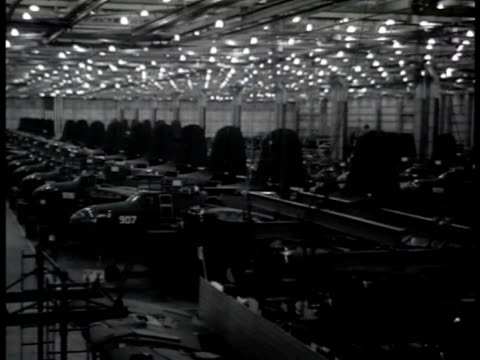 Women working on exterior of airplane woman FG working w/ riveter 'Rosie the Riveter' HA WS INT Warehouse filled w/ airplanes Mechanics working on...