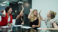 Women Working Together - High Fiving