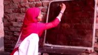 Women writing on blackboard