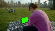Women young adult computer chroma key green screen Central Park NYC
