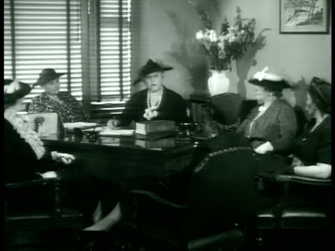 Women's Club meeting in office REPRISING conversation about dishonest practices hurting reputable shops INTERTITLE 'Heartily supporting growing...