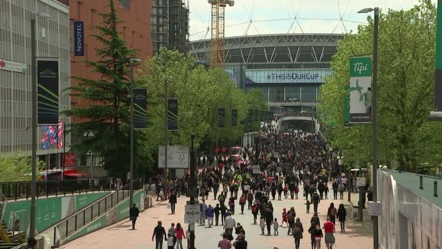 Women's FA Cup final Arsenal Ladies v Chelsea Ladies ENGLAND London Wembley Stadium EXT Fans arriving at Wembley Stadium Electronic sign 'We're Proud...