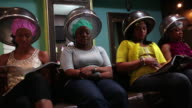 MS Women's getting hair steam in beauty parlor / Irvington, New Jersey, United States